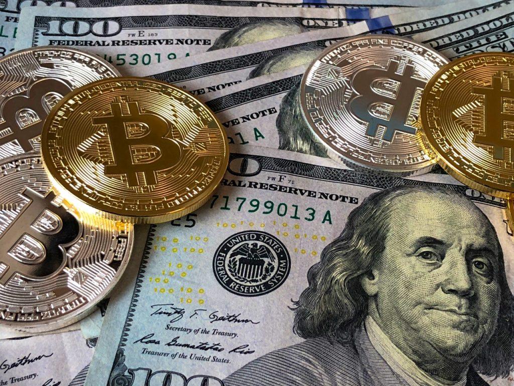 bitcoins and u s dollar bills 730547
